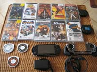 Sony Playstation Portable with case, 2G card, 11 games and 2 movies. Fun for adults and kids. Perfect condition. Value: $600+ Sale: $250 829-401-3639